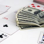 cards and dollar 150x150 - 3 Movies to Improve Your Michigan Gambling